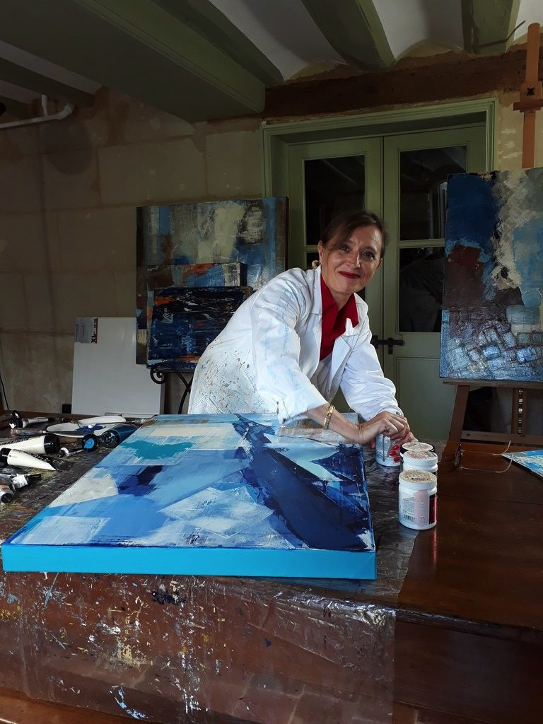Priscille at her painting workshop